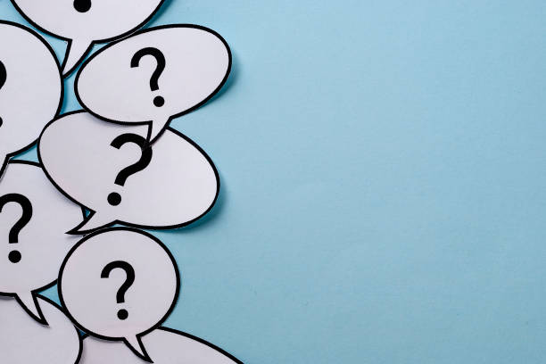 Speech or thought bubbles with question marks stock photo
