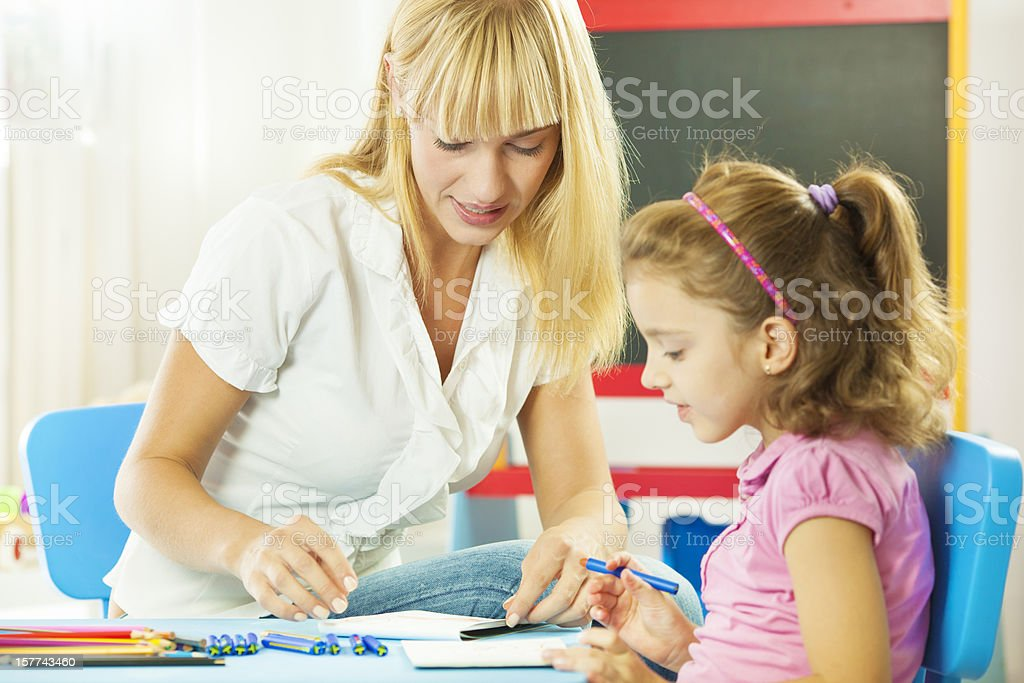 Speech Therapist Interacting with child royalty-free stock photo