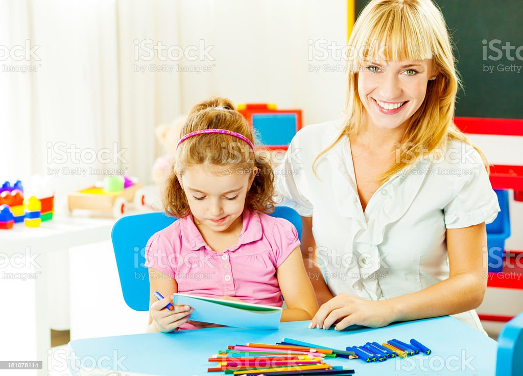 Speech Therapist Interacting with child. royalty-free stock photo