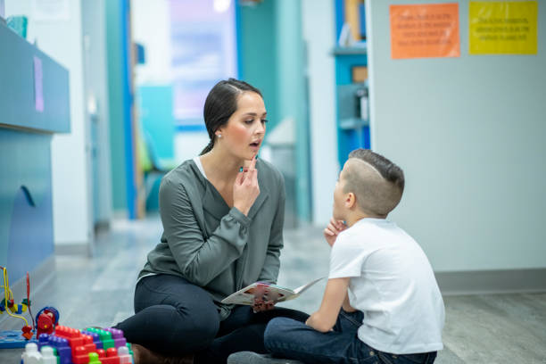 Speech Therapist Sitting With a Child stock photo stock photo