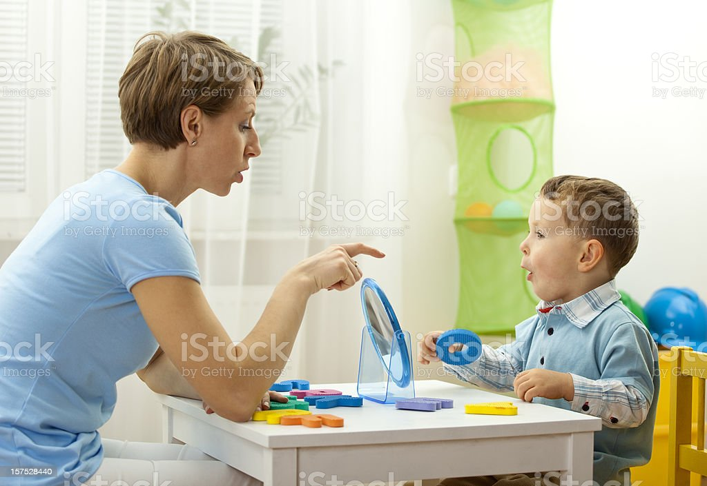 speech therapist with child royalty-free stock photo