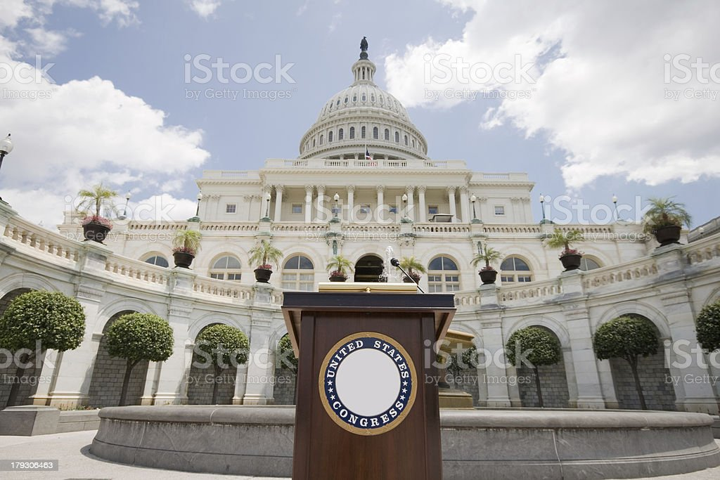 Speechifying US Capitol Building Podium Set Up for Press Conference US Capitol building with a podium set up for a photo op. Architectural Dome Stock Photo