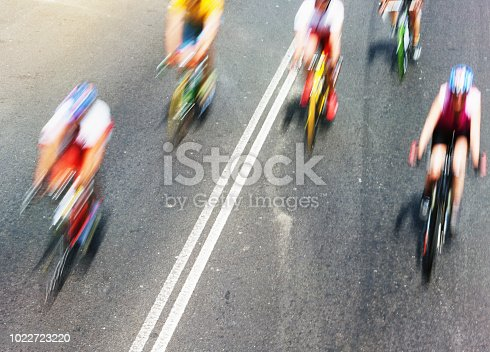 High angle view of racing cyclists blurred by speed.