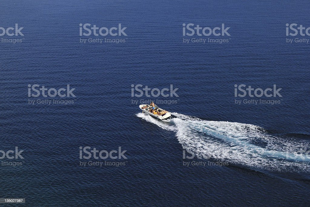 Speed boat aerial view on blue sea stock photo
