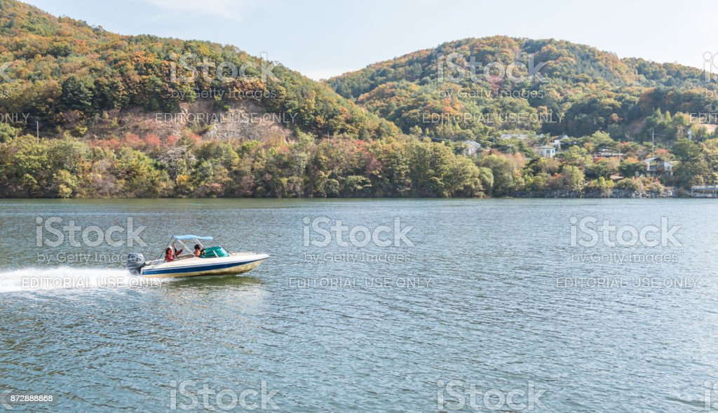 Speed boat goes past Nami Island in South Korea stock photo