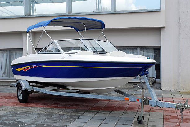 speed boat on trailer ready for transport stock photo
