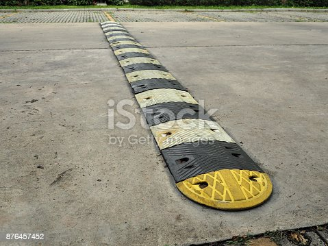 istock Speed bump on a concrete road 876457452