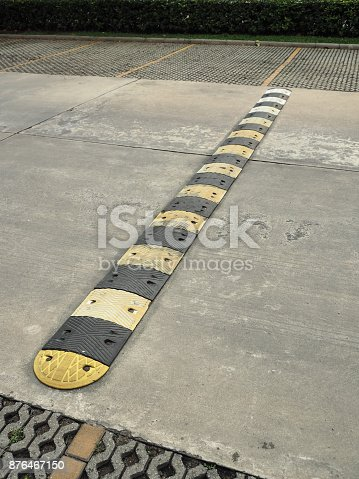 istock Speed bump on a concrete road 876467150