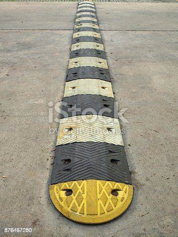 istock Speed bump on a concrete road 876467280