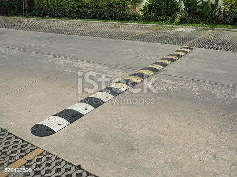 istock Speed bump on a concrete road 876467528