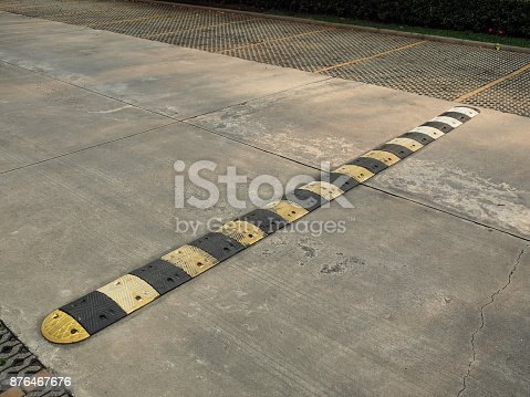 istock Speed bump on a concrete road 876467676
