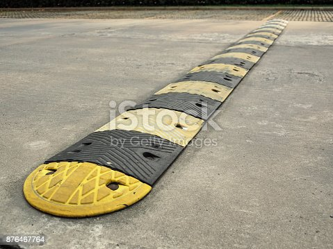 istock Speed bump on a concrete road 876467764
