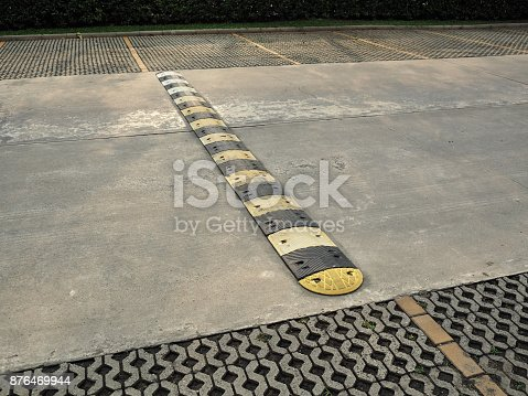 istock Speed bump on a concrete road 876469944