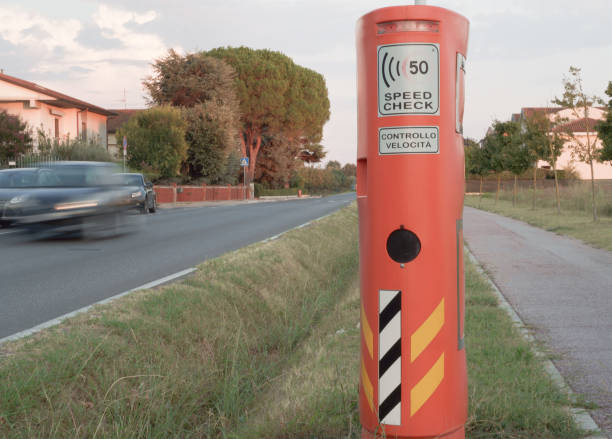 speed camera and car in Italian countryside village stock photo