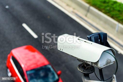 Speed camera monitoring traffic on UK Motorway.