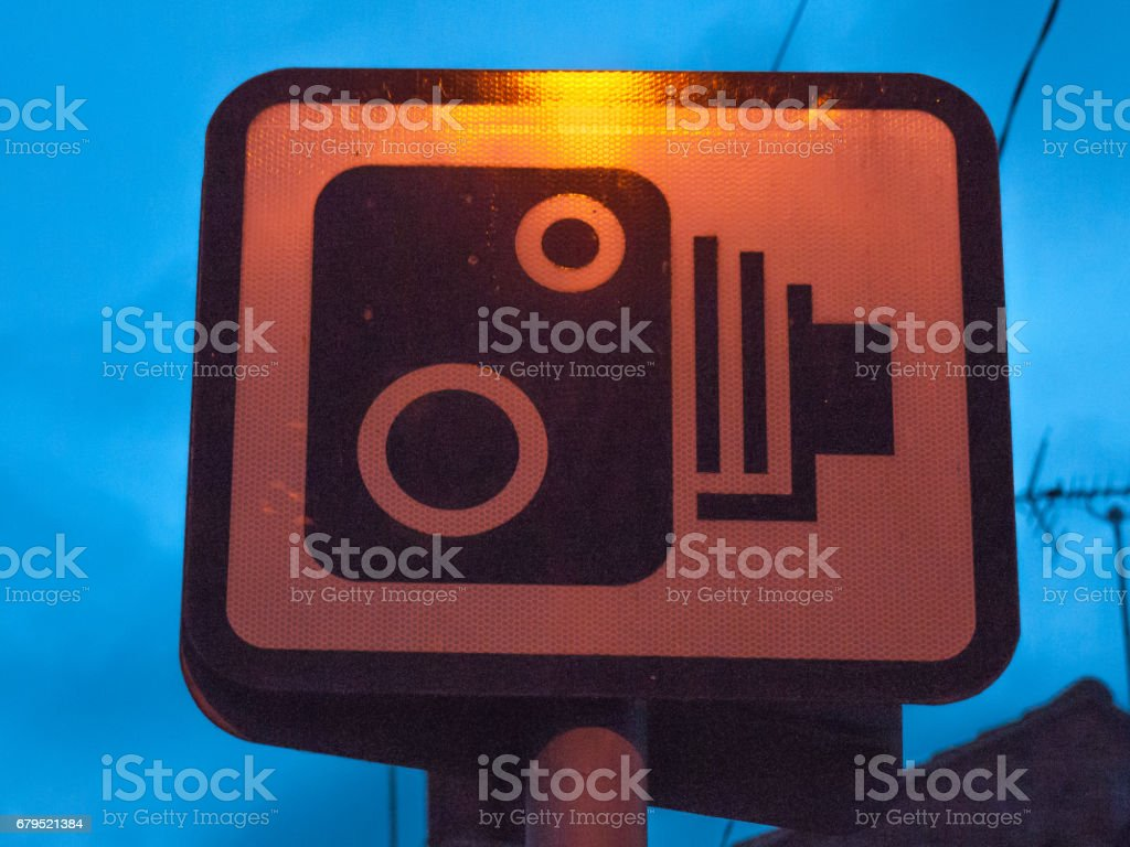 speed camera warning sign outside at night stock photo