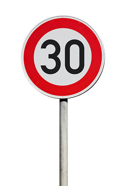 Speed limit 30 kilometers traffic sign isolated stock photo