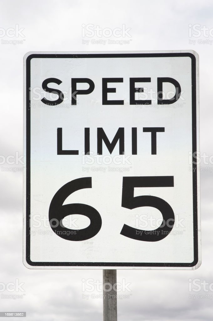 Speed Limit Sign 65 Miles Per Hour stock photo