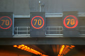 speed limit signs, 70, street light, fog, tunnel