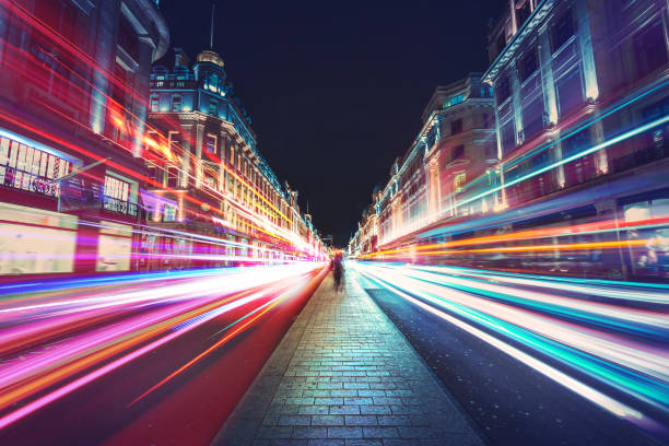 Speed of light in London city Speed of light in London city long exposure stock pictures, royalty-free photos & images