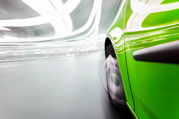Speed View from a very fast car in motion - urban city scene with motion blur and focus on the tire. alternative fuel vehicle stock pictures, royalty-free photos & images