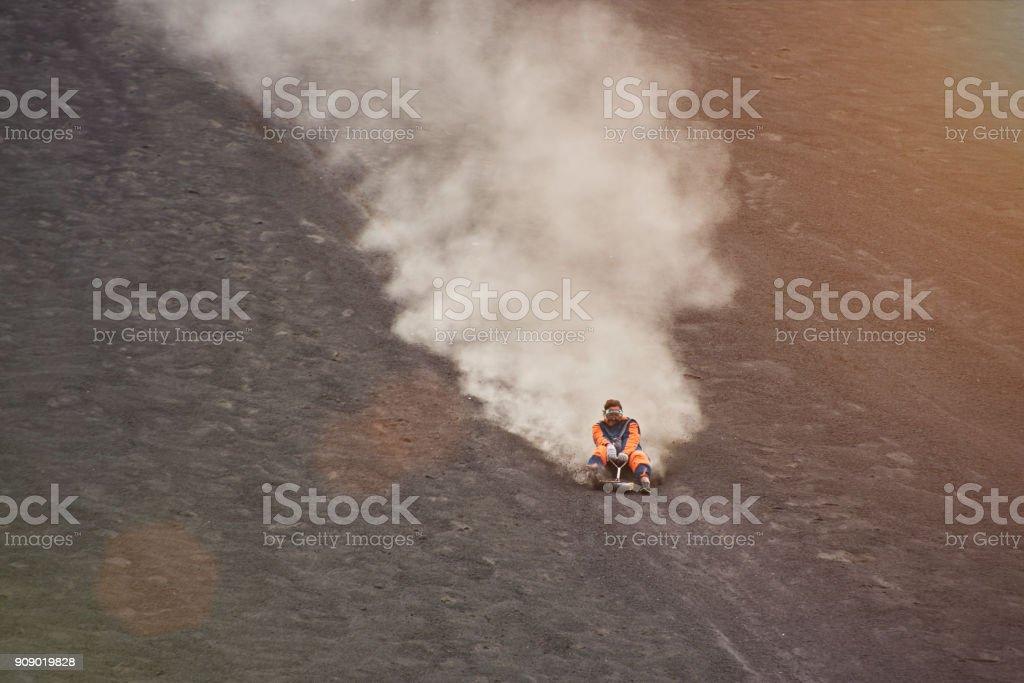 Speed ride on volcano boarding stock photo