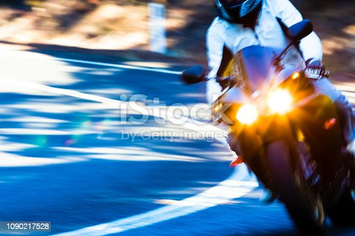 istock Speed, riding motorcycle on the highway, background with copy space 1090217528
