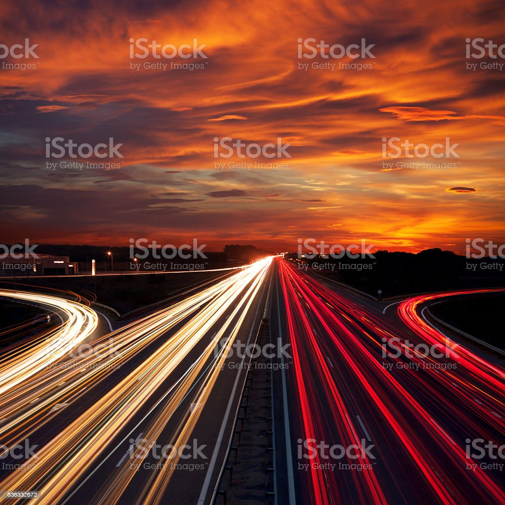 Speed Traffic at Sundown Time - light trails on  highway stock photo