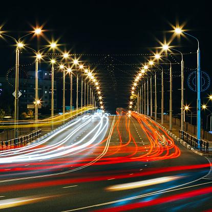 824108398 istock photo Speed Traffic - Light Trails On City Road At Night 521132291
