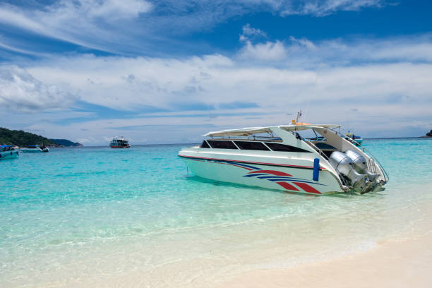 Speedboat anchored on tropical beach stock photo