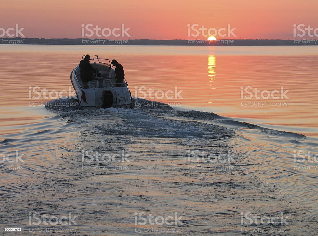 Speedboat in sunset stock photo