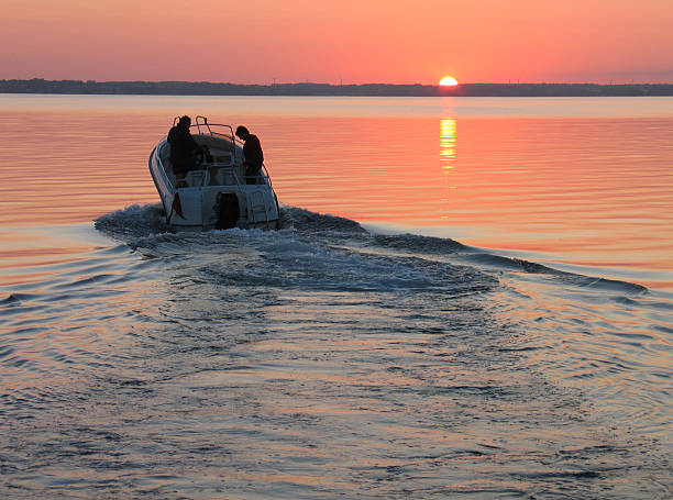 speedboat in sunset - sail stock pictures, royalty-free photos & images