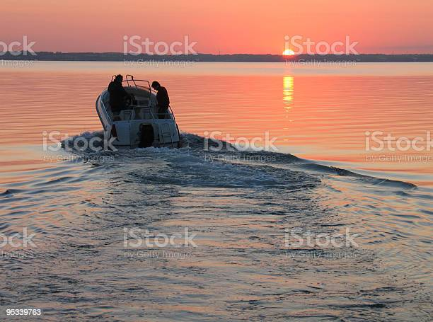 Photo of Speedboat in sunset