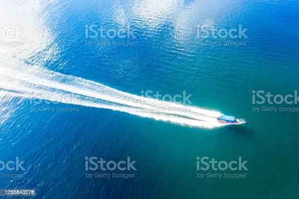 Photo of Speedboat racing along the open sea