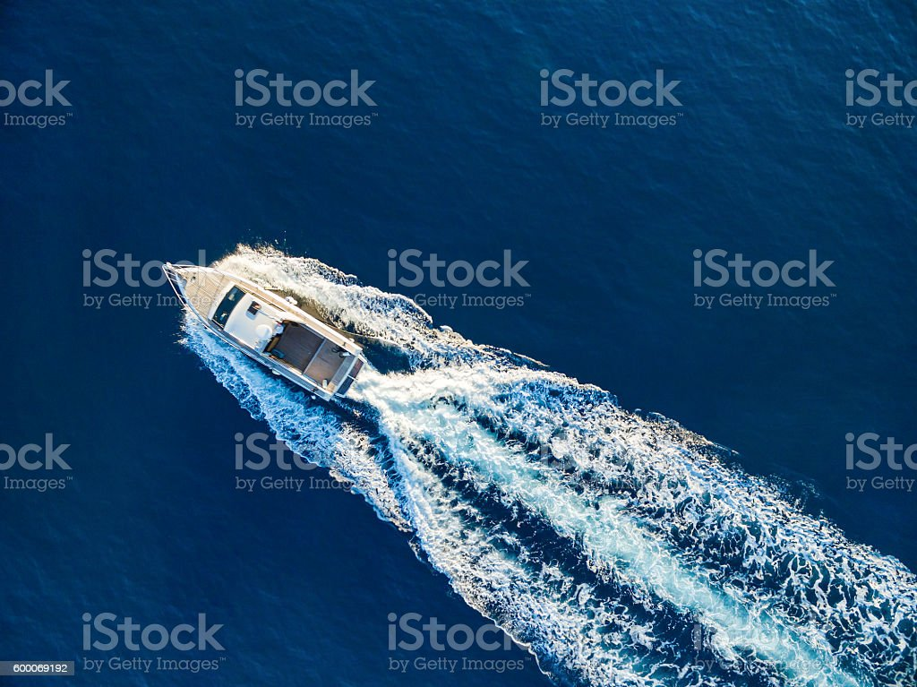 Speedboat racing at the open sea stock photo
