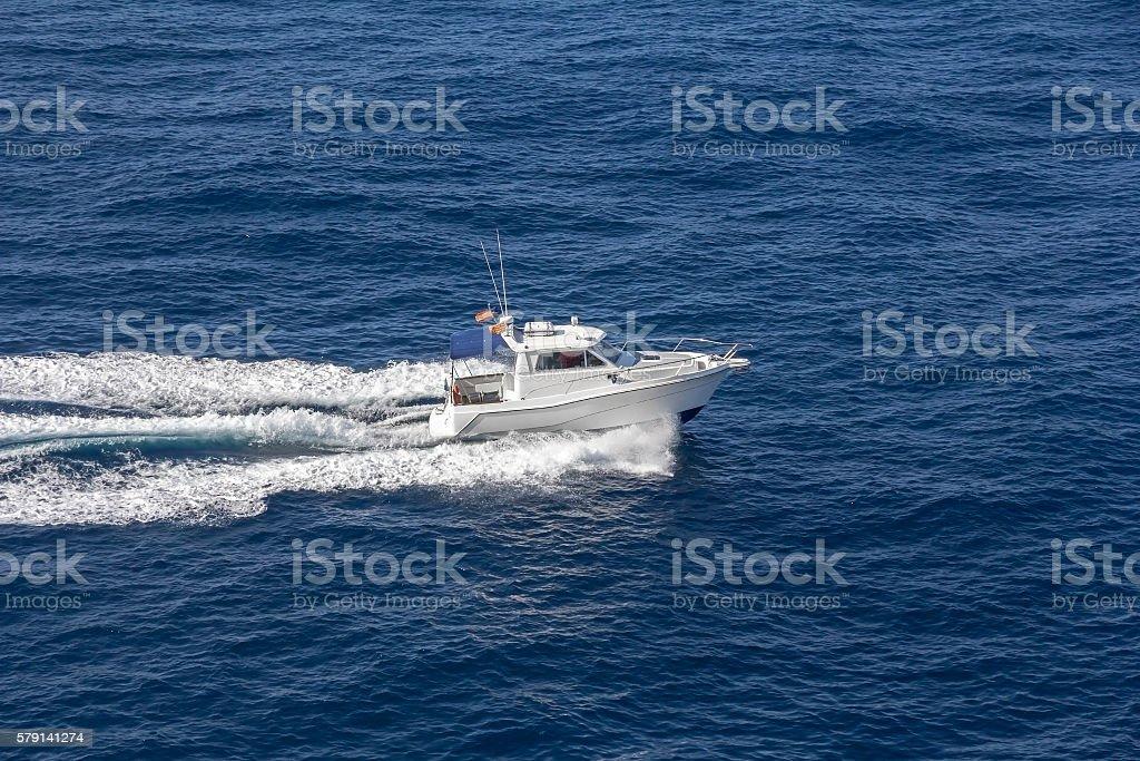 Speedboat rides on the sea stock photo