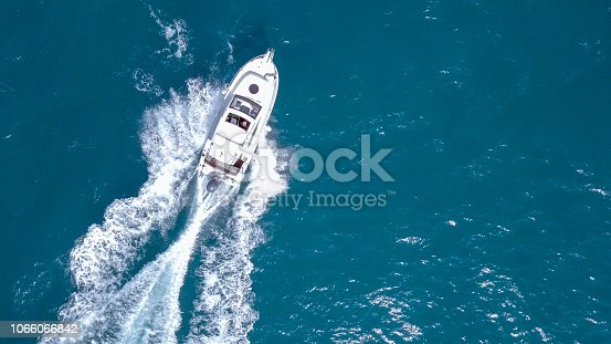Speedboat roaring across the Mediterranean Sea - Top down aerial image