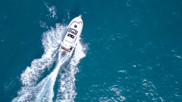 speedboat roaring across the mediterranean sea - nautical vessel stock pictures, royalty-free photos & images