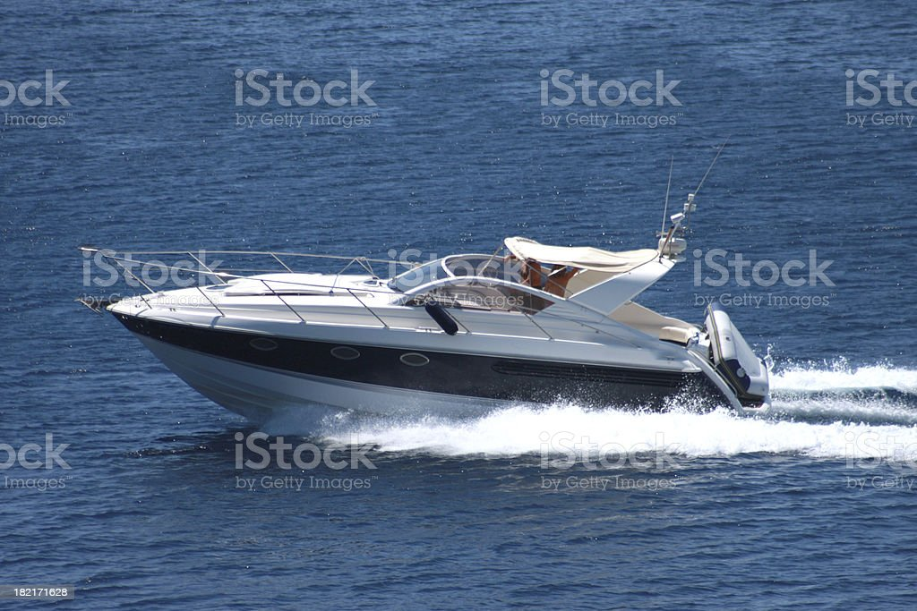 A speedboat sailing on the ocean royalty-free stock photo