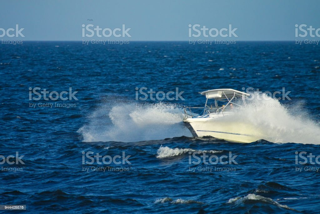 Speedboat speeding fast splashing water stock photo