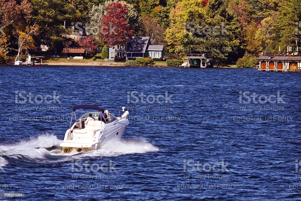 Speedboat speeding towards destination on lake Gorge royalty-free stock photo