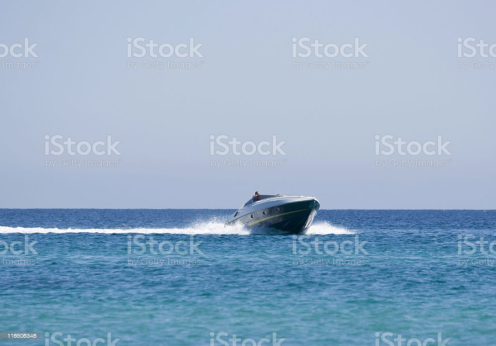 speedboat with captain royalty-free stock photo