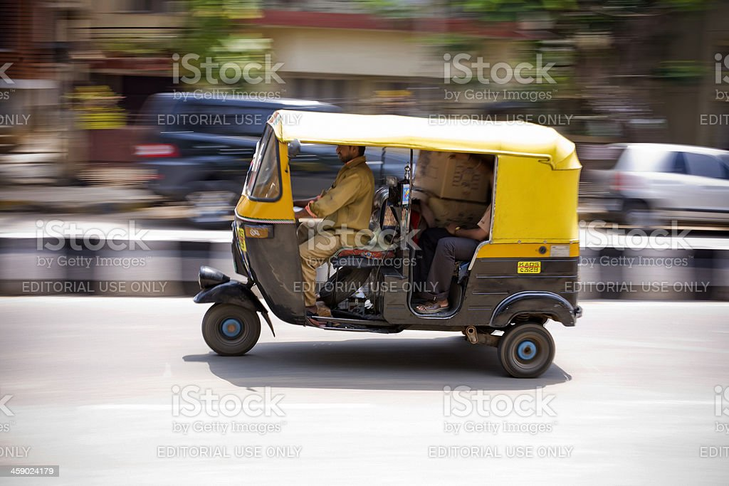 Speeding Auto Rickshaw stock photo