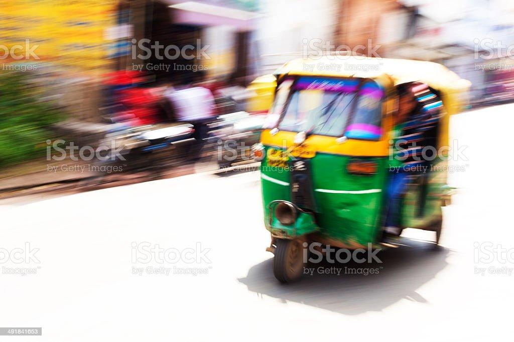 Speeding Auto Rickshaw Taxi stock photo