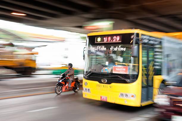 speeding bus in bangkok, thailand - motorbike, umbrella stock photos and pictures