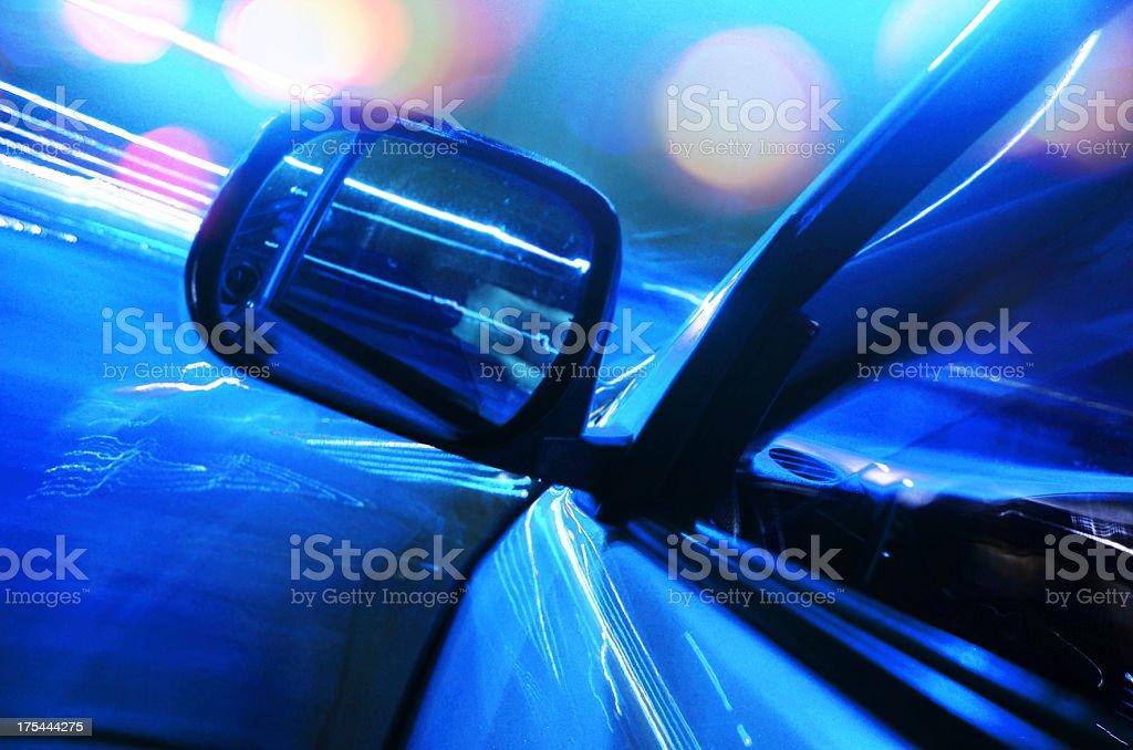 speeding car at night stock photo
