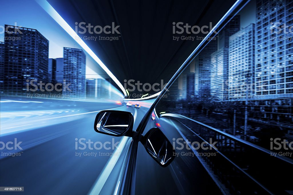 speeding car in night at street stock photo