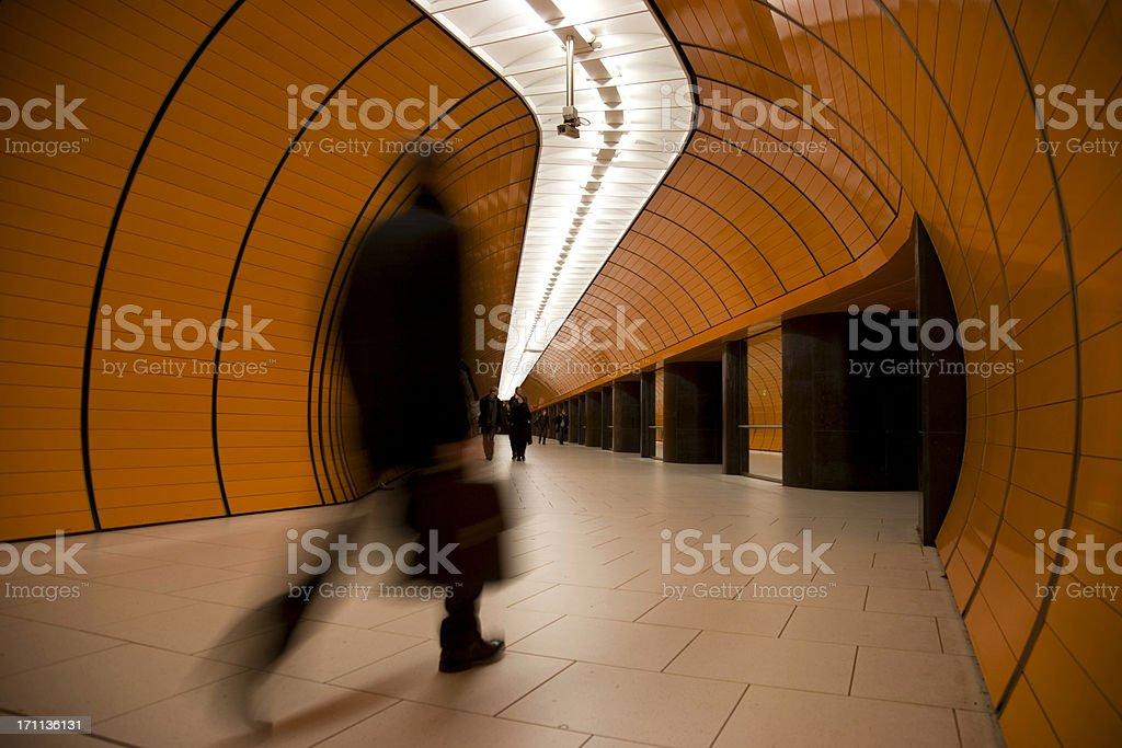 speeding commuter in mordern orange tube XL royalty-free stock photo
