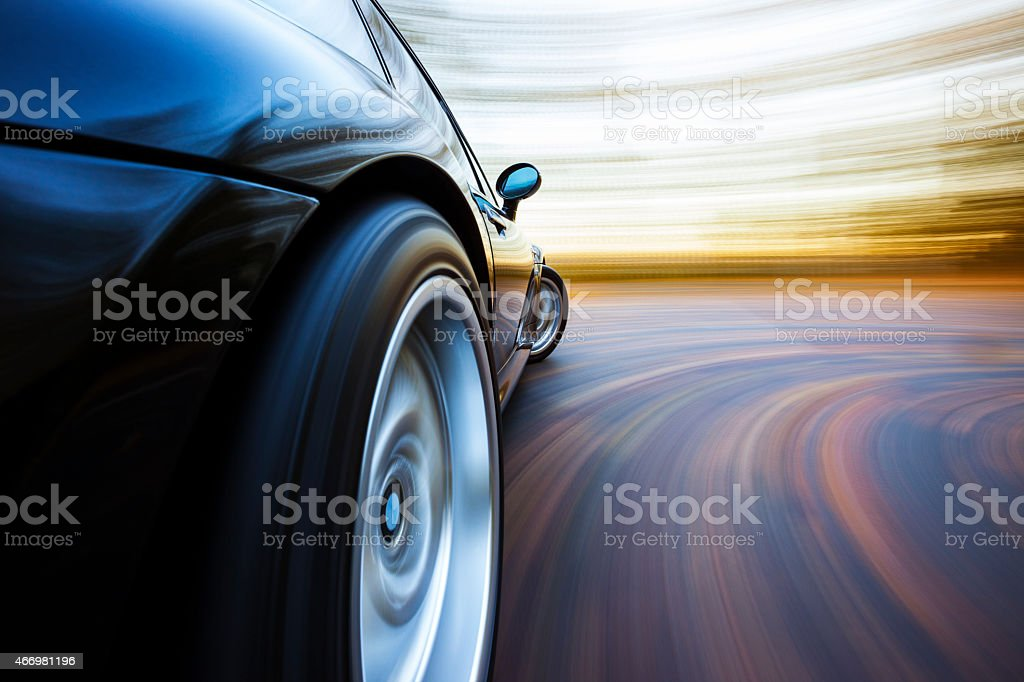 Speeding Curve Sports Car. stock photo