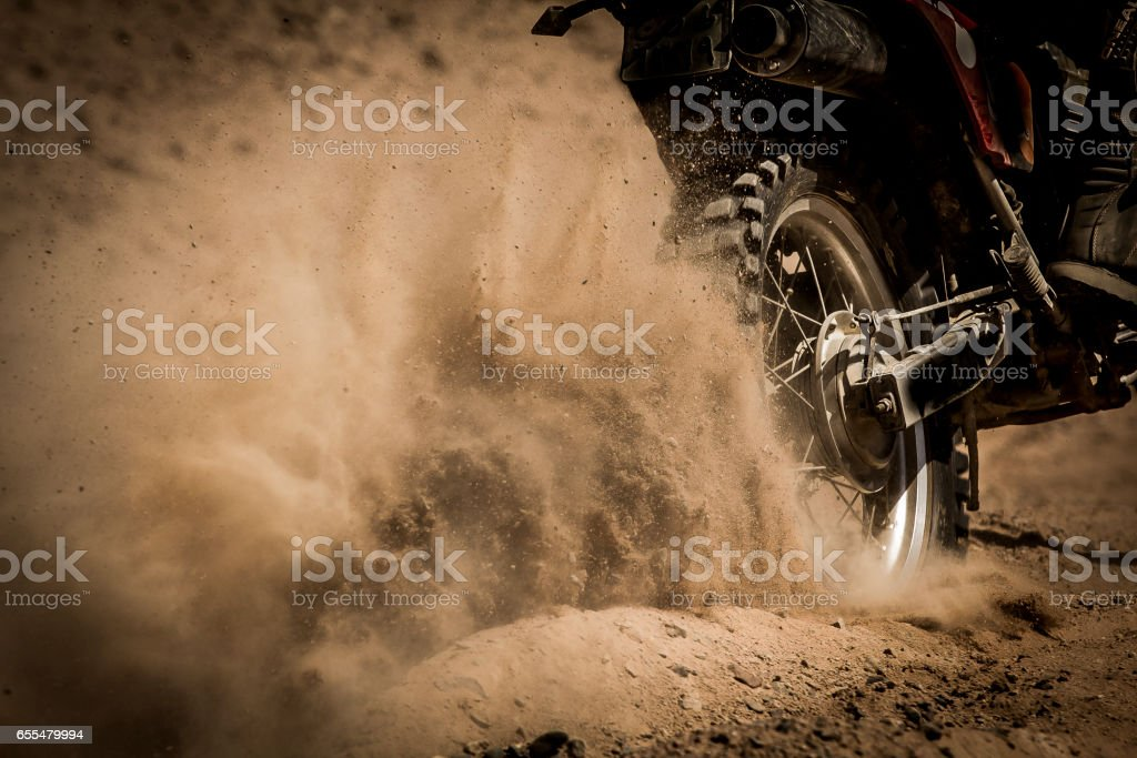 Speeding Dirt bike on a sand track stock photo